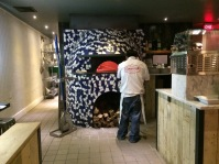 Capofitto's oak-burning pizza oven.