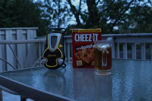 A scene at dusk: Cheez-Its, iced tea and portable radio on the deck table behind my house. Photograph by Sandra Cherrey Scheinin