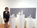Leora Brecher with some of her sculptures at MUSE Gallery.
