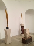 The two tall works are Brancusi's Bird sculptures.